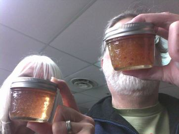 Photo of two different jelly samples and two people holding them.
